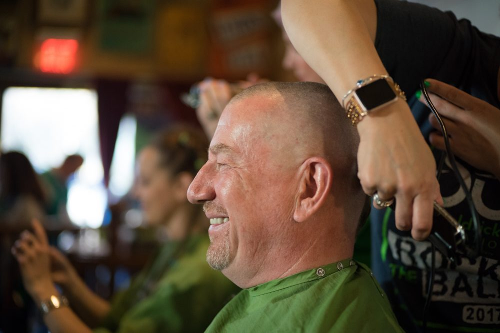 a man getting his head shaved