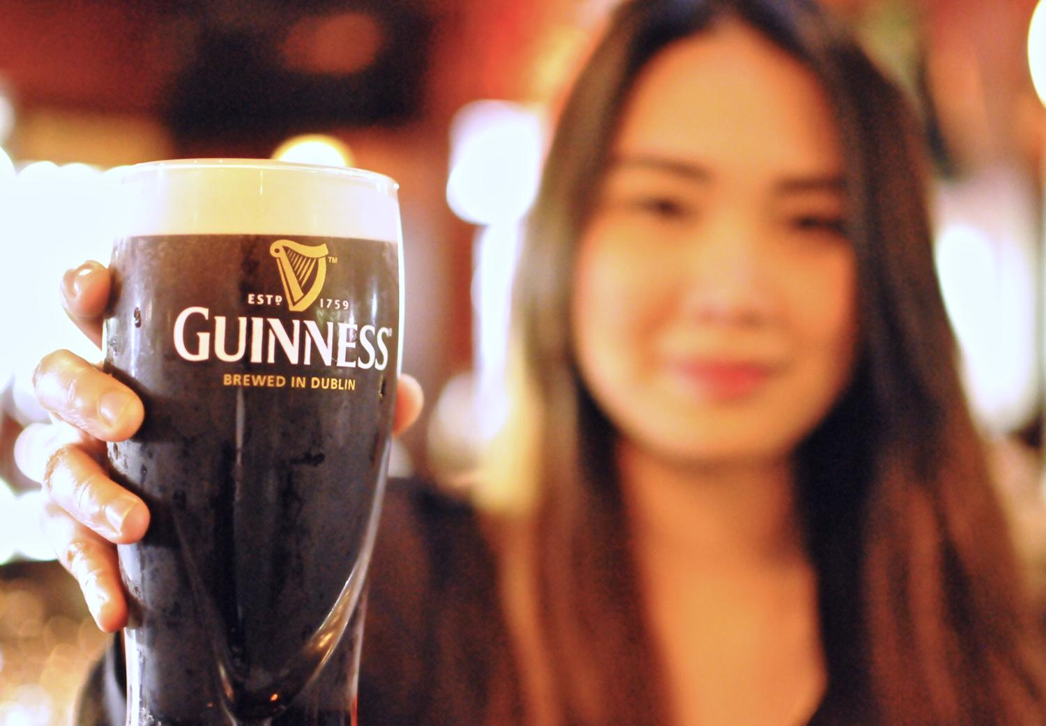 bartender with guinness pint