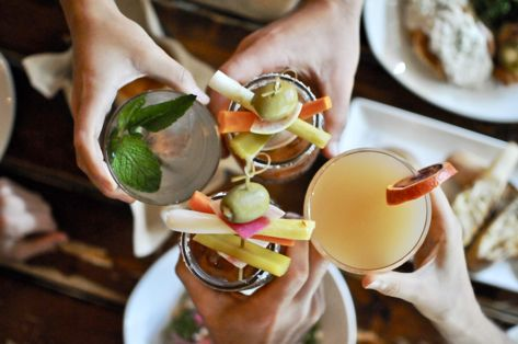 people cheersing brunch drinks